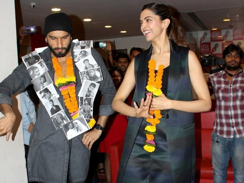 Oh, that spark and charm you bring in my eyes! Ranveer Singh and Deepika Padukone during the promotion of Bajirao Mastani in Mumbai.  (IANS)