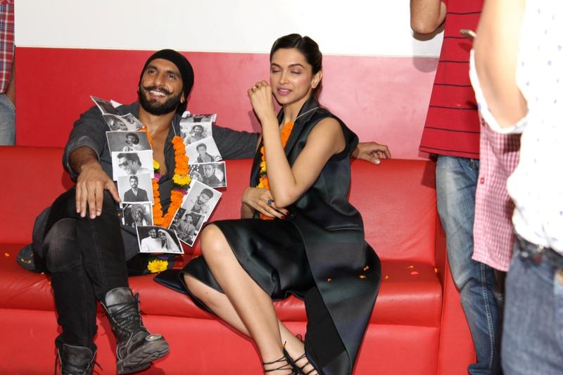 Too much light, is it, Deepika? Well, you've got Ranveer to soothe your eyes! (IANS)
