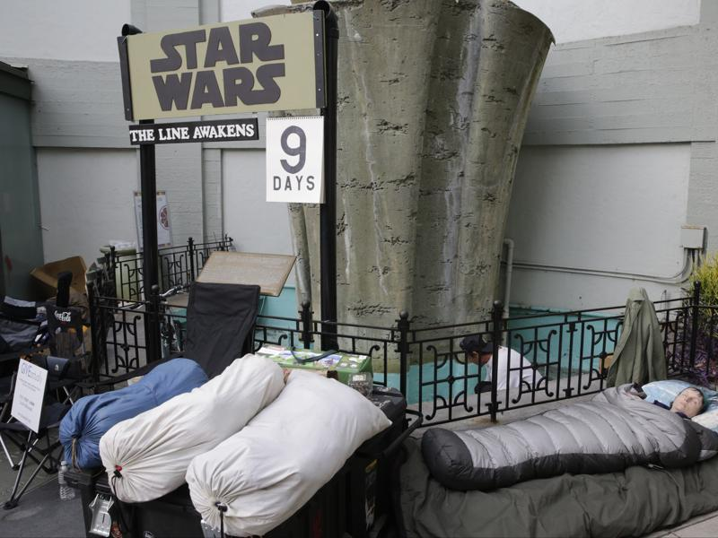 Star Wars fan Caroline Ritter of Hunter Valley, Australia, sleeps while waiting first in line for a chance to see the latest episode in the Star Wars Saga, Star Wars: The Force Awakens at the TCL Chinese Theater Imax in Los Angeles. Ritter is planning to get married at the historic theatre with a Star Wars themed wedding before the premiere of the film. (AP)