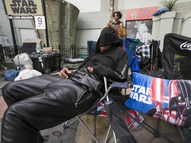Star Wars fan, actor Deuce Wayne from Virginia rests outside the TCL Chinese Theater Imax while waiting for the premiere of Star Wars: The Force Awakens. (AP)