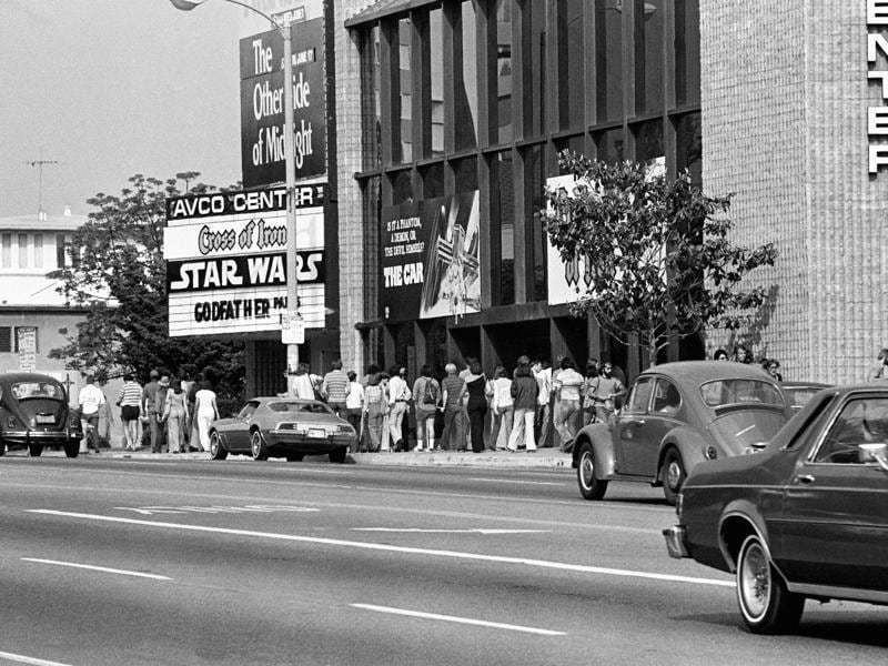 In this June 7, 1977 file photo, theatre goers wait in line here at Avco Center Theater in Los Angeles to see the smash-hit movie, Star Wars, which had seats sold out for every performance and had grossed $5.2 million since it opened 12 days ago.  (AP)