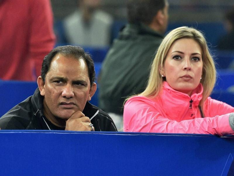Former cricketer Azharuddin watches Indian aces Sania Mirza and Rohan Boppana's match against Phillippine Mavericks players Tomljanovic and Huey at IPTL at IG stadium in New Delhi . (PTI)