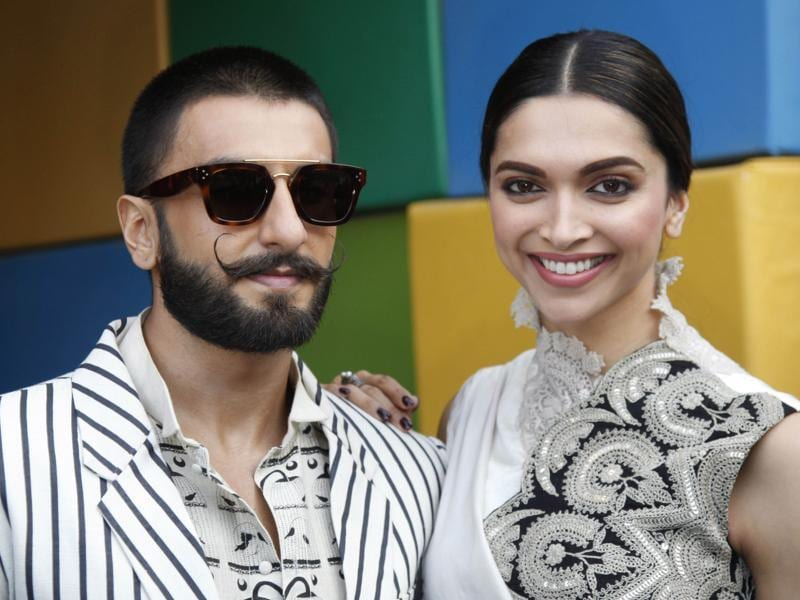 Ranveer Singh and Deepika Padukone pose for photographs before a press conference to promote their upcoming movie Bajirao Mastani in Ahmedabad Dec. 10, 2015.  (AP)