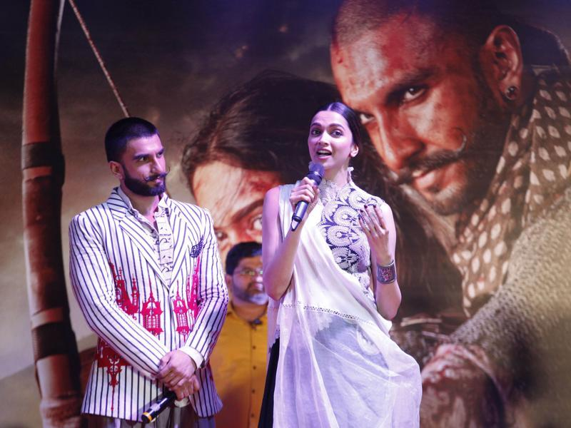 Ranveer Singh is completely in awe of Deepika Padukone as she speaks during a promotional event for their upcoming movie Bajirao Mastani. (AP)