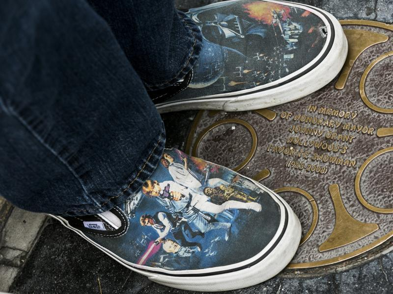 A Star Wars fan wearing Star Was-themed sneakers lines up outside the TCL Chinese Theater Imax for the Star Wars: The Force Awakens premiere. (AP)