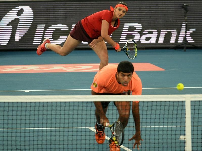 India's Sania Mirza of the Indian Aces  serves past partner and compatriot Rohan Bopanna during the International Premier Tennis League (IPTL) tennis match between Indian Aces and Philippine Mavericks in New Delhi. (AFP)