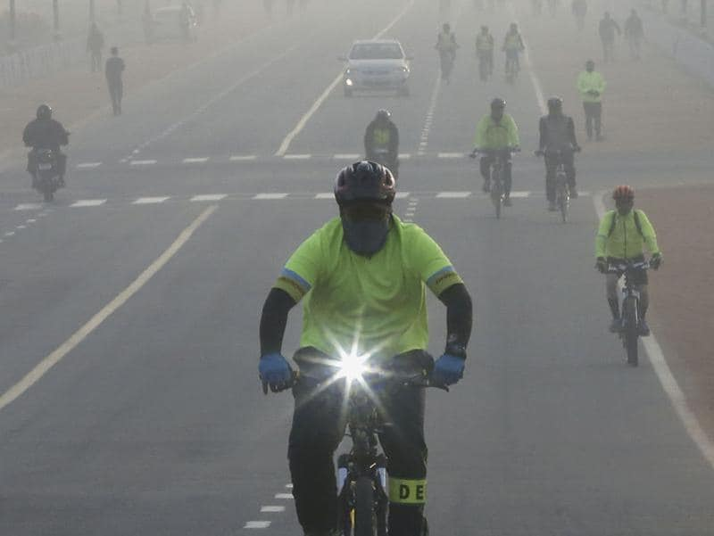 People cycling in a foggy weather at Rajpath in New Delhi. (Ravi Choudhary/ HT Photo)