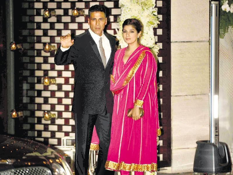 Akshay Kumar with wife Twinkle Khanna at the bash to celebrate the two weddings. (HT Photo)