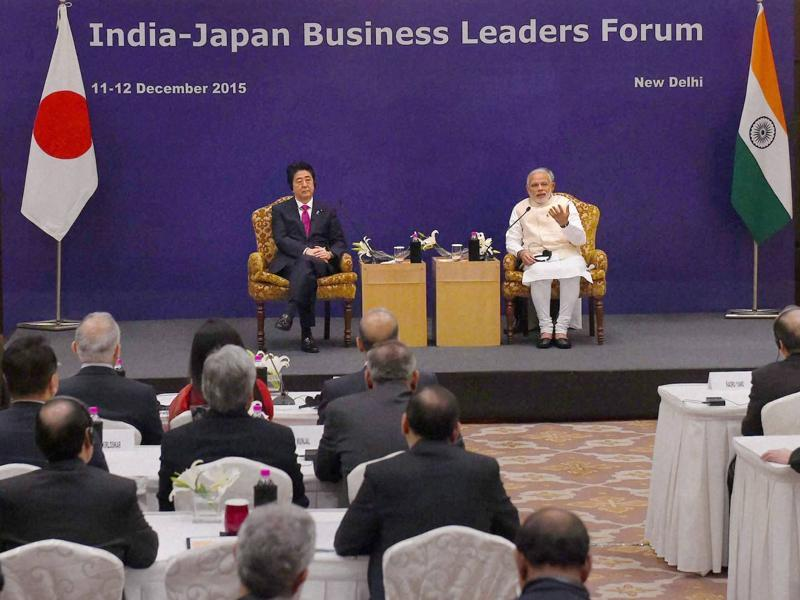 The Prime Ministers of Japan on the left and India on the right at the India-Japan Business Leaders Forum in New Delhi on Saturday. (PTI)