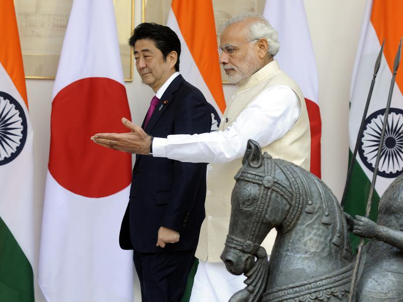 PM Narendra Modi escorts his counterpart from Japan Shinzo Abe as they arrive for their delegation level meeting at Hyderabad House in New Delhi on Saturday. Abe's visit marked a major step in transforming India into an economic powerhouse with Japan's help in building bullet trains, smart cities and nuclear technology exchange. (Sonu Mehta/HT Photo)