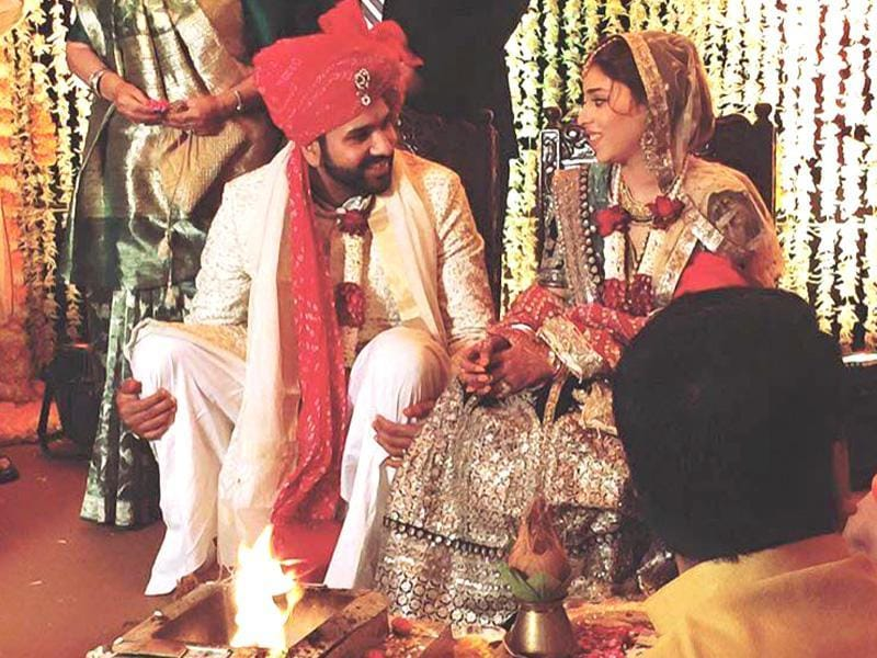 Running between the wickets: Rohit sneaks a moment to talk to his bride Ritika during the rituals. (Twitter)