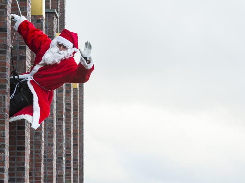 A man dressed as Father Christmas aka Santa Claus climbs down the Kollhoff tower on December 13, 2015 as part of a yearly stunt before the festive season.  (AFP)