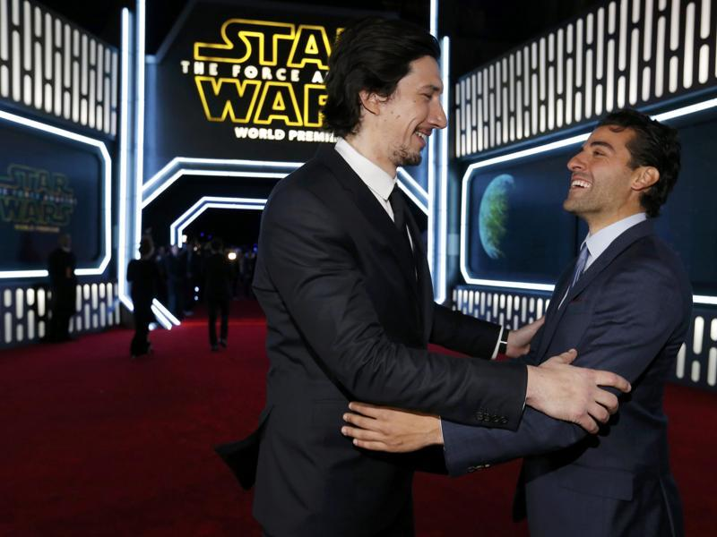 Actors Adam Driver (L) and Oscar Isaac arrive at the premiere of Star Wars: The Force Awakens in Hollywood, California. (REUTERS)