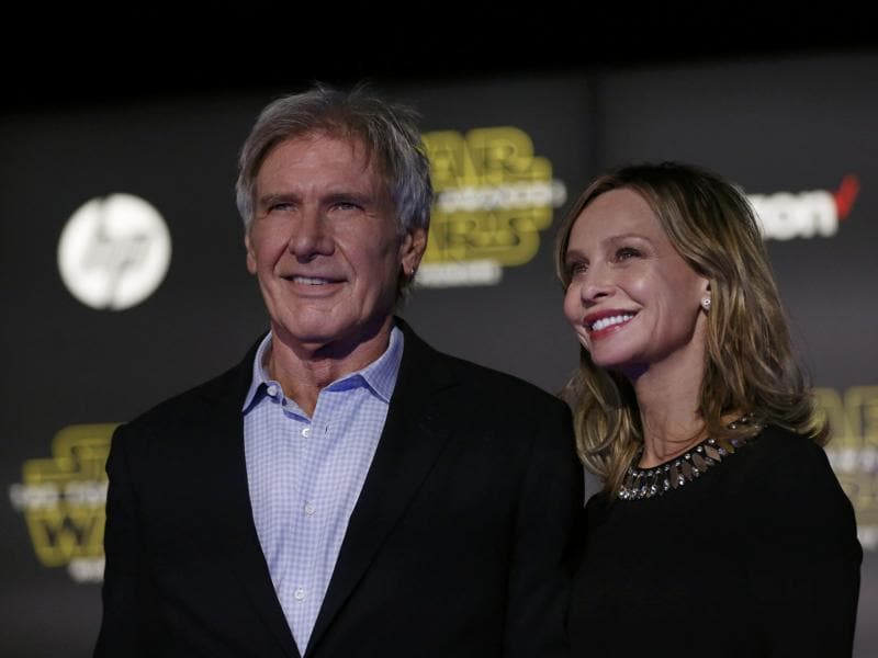 Actor Harrison Ford, who plays Han Solo and his wife, actress Calista Flockhart, arrive at the premiere of Star Wars: The Force Awakens in Hollywood, California. (REUTERS)
