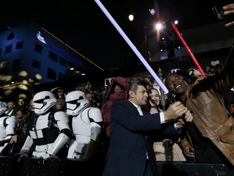 Actor Andy Serkis poses with fans as he arrives at the premiere of Star Wars: The Force Awakens in Hollywood. (REUTERS)