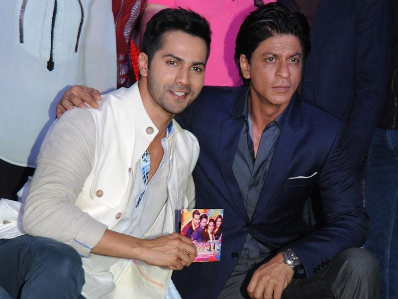 Varun Dhawan and Shah Rukh Khan pose during the music celebration of the upcoming Hindi film Dilwale. (AFP)