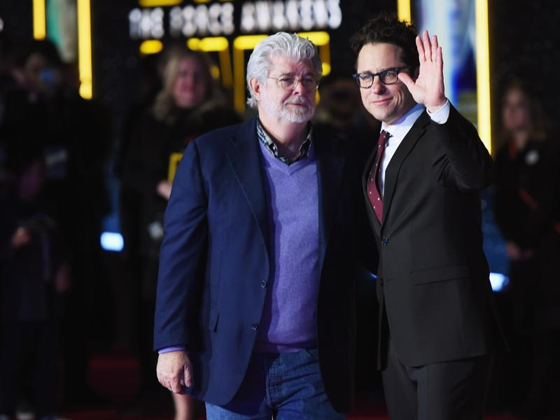 Filmmaker George Lucas (L) and writer-director JJ Abrams attend the Premiere of Walt Disney Pictures and Lucasfilm's Star Wars: The Force Awakens on December 14, 2015 in Hollywood, California. (AFP)