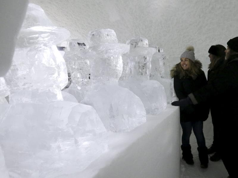 Guests looking at ice sculptures inside a room in the Ice hotel in Sweden. The project-cum-hotel, now 25 years old, is in Jukkasjärvi, a tiny little town 200 km north of the Arctic Circle. (REUTERS)