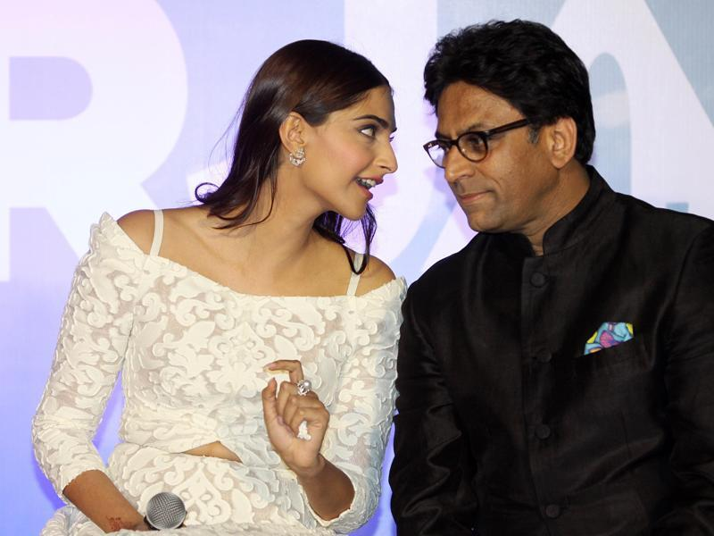 Sonam Kapoor speaks with her director Ram Madhvani during the trailer launch of Neerja in Mumbai. (AFP)