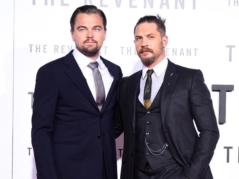 Actors Leonardo DiCaprio and Tom Hardy arrive at the premiere of The Revenant. (AFP)