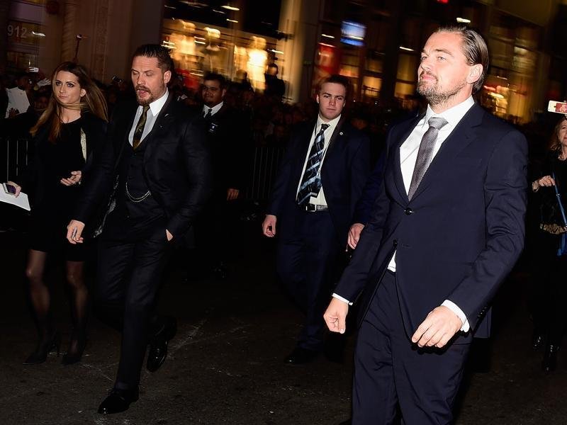 Actors Tom Hardy and Leonardo DiCaprio arrive at the premiere of The Revenant. (AFP)