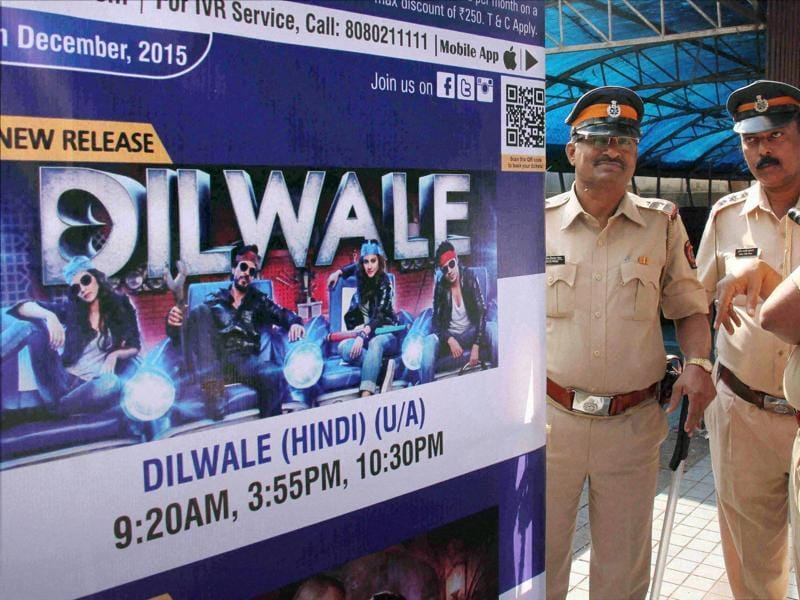 Policemen guard outside a cinema hall in the view of Hindu Rashtriya Sena's protest against Shah Rukh Khan's Dilwale in Mumbai on Friday.  (PTI)