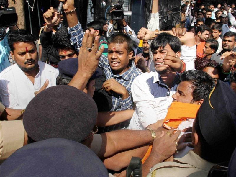 Police stop Hindu Rashtriya Sena activists who were staging a protest against Shah Rukh Khan's film Dilwale in Mumbai on Friday.  (PTI)