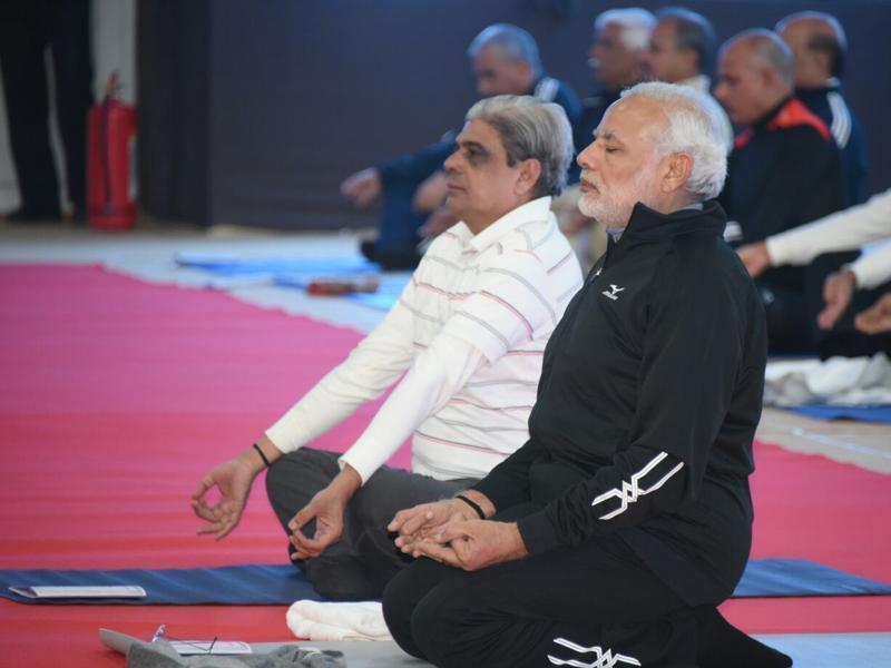 Modi will lead around 150 top cops from all the security agencies, Home minister Rajnath Singh and national security adviser Ajit Doval in 45-minute yoga sessions on December 19 and 20. (ht PHOTO)