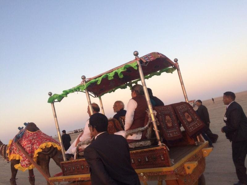 PM Narendra Modi enjoys a camel cart ride after surya namaskar and yoga session on Saturday morning. (HT PHOTO)