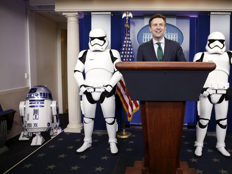 A Star Wars Stormtrooper gives a thumbs up as White House Press Secretary Josh Earnest speaks from the rostrum as R2-D2  enters the briefing room  of The White House. The Star Wars characters were at the White House for a private screening of Star Wars: The Force Awakens which was shown to first lady Michelle Obama and Gold Star Families.   (REUTERS)