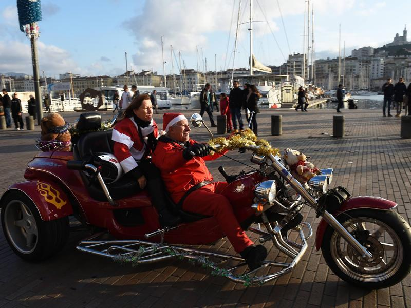 Two bikers, dressed as Santa Claus, with their collection of toys for children admitted in hospitals in Marseilles, France.  (AFP)
