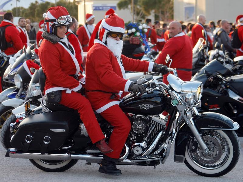 Members of the Sliders Massilia Motor Club, in Santa Claus costumes, on the Old-Port, in Marseille. Every rider brought a new toy for the children hospitalised in the public hospitals of Marseille area.  (AP)