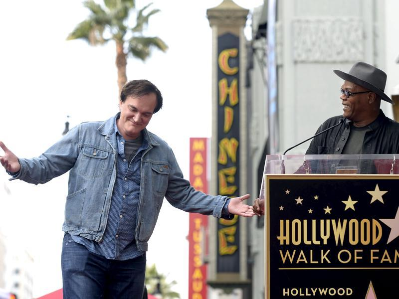 Filmmaker Quentin Tarantino is introduced by actor and event emcee Samuel L Jackson before the unveiling of his star on the Hollywood Walk of Fame in Hollywood, California. (REUTERS)