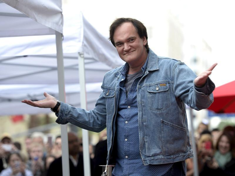 Filmmaker Quentin Tarantino acknowledges fans before the unveiling of his star on the Hollywood Walk of Fame in Hollywood. (REUTERS)