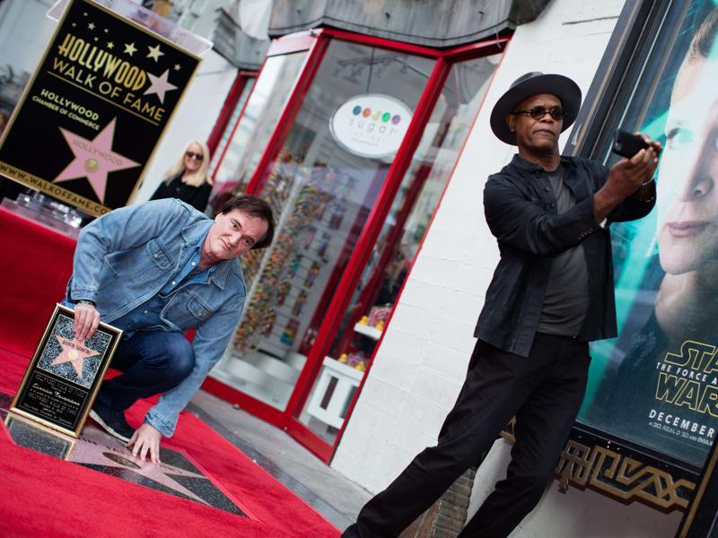 Filmmaker and Director Quentin Tarantino and actor Samuel L Jackson pose at the Hollywood Walk of Fame. (AFP)