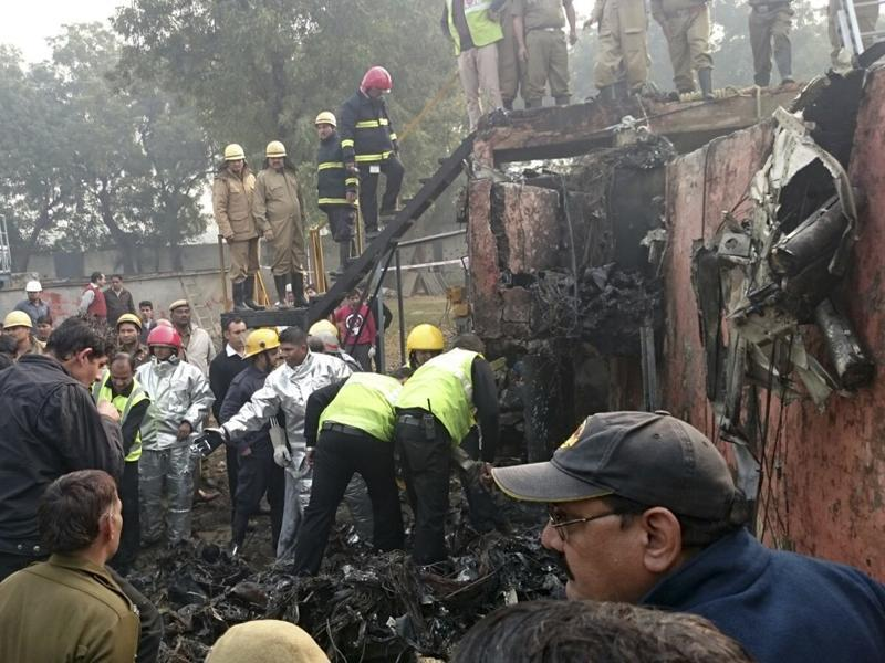 A Ranchi-bound BSF aircraft narrowly missed an express train and crashed in west Delhi's Dwarka after developing a technical snag, killing all ten passengers on board. (HT Photo)