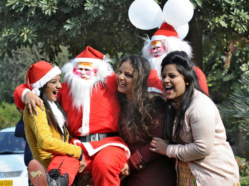Chandigarh residents having fun during a procession to mark the coming of Christmas on Wednesday.  (Gurpeet Singh/HT Photo)
