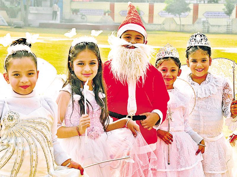 Children dressed up in colourful costumes during their school's Christmas celebrations in Ludhiana. (Sikander Singh Chopra/HT photo)