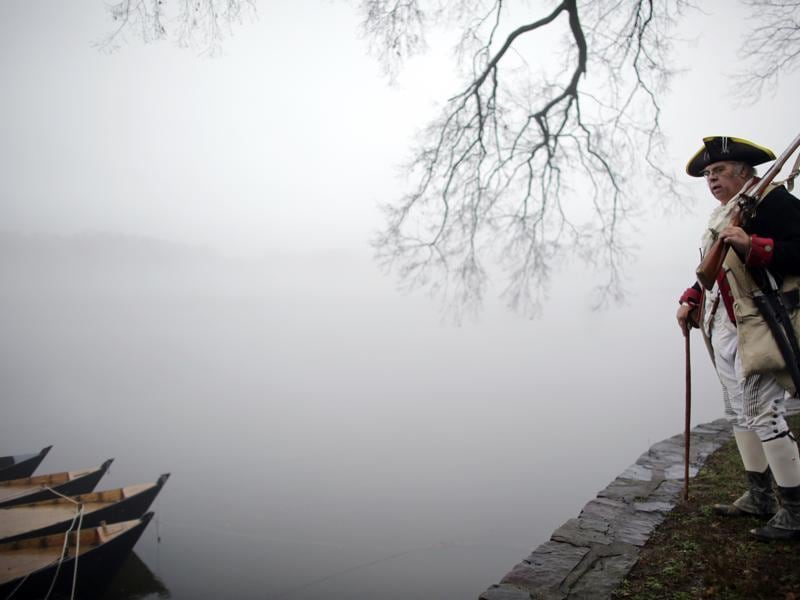 Revolutionary War re-enactor Bill Strunk looks at the fog covering the river before the re-enactment of Washington crossing the Delaware River. (AP)