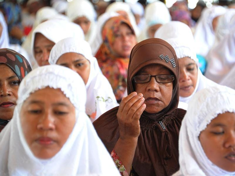 Women attend a prayer gathering at Lampuuk village in Indonesia to commemorate tsunami victims on the 11th anniversary of the tragedy. (AFP)