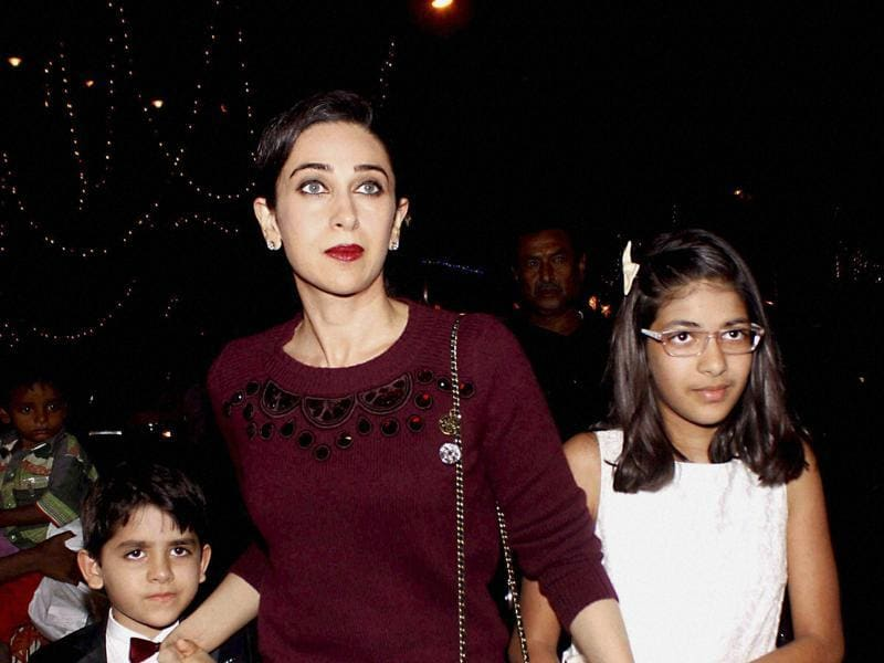 Karishma Kapoor along with her children attend a Midnight Mass in Mumbai.  (PTI)