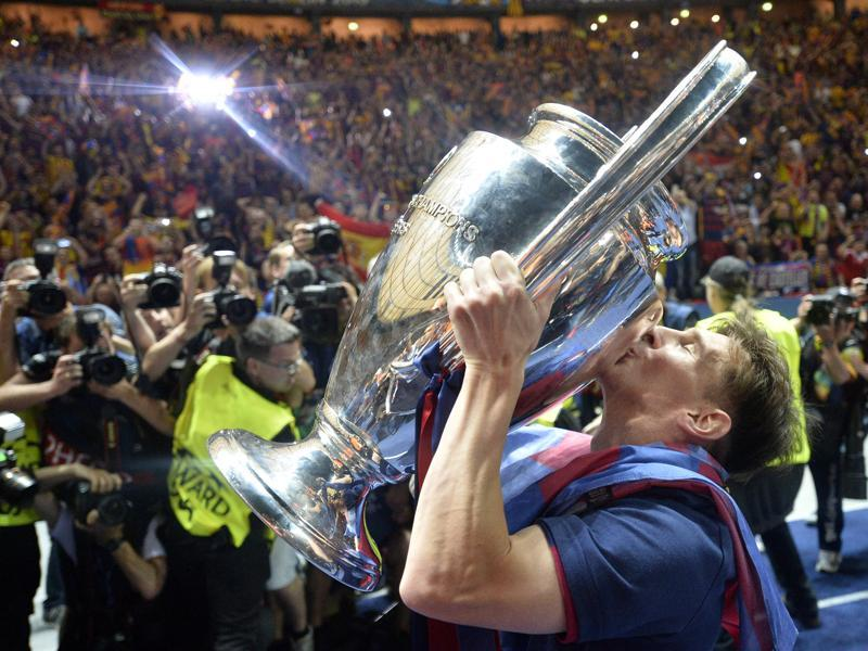 Treble winners for the second time: Barcelona's Lionel Messi kisses the Champions League trophy after his team defeated Juventus 3-1 in the final. Barcelona became the first European team to win the season's La Liga, Copa del Rey and Champions League on two occasions. (AP Photo)
