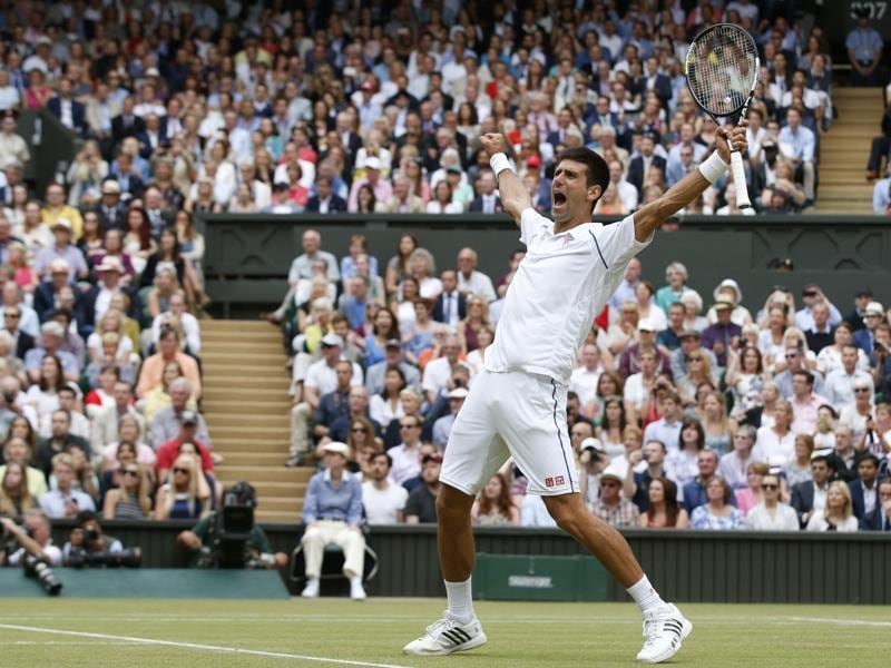 Novak, the unstoppable: Novak Djokovic celebrates winning Wimbledon. The Serb won 11 titles, including three Grand Slams, six Masters 1000 titles, and went 82-6 for the year. (AP Photo)