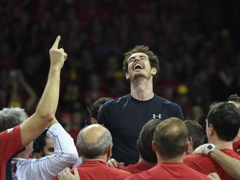 Andy Murray, saviour of British sport: Andy Murray (C) celebrates with teammates after Britain won the Davis Cup for the first time since 1936. (AFP Photo)