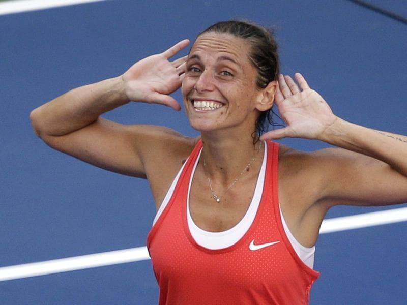 """Show me some love,"" says Italy's Roberta Vinci, who defeated Serena Williams in the semifinals of the US Open, springing arguably the upset of the year and denying Williams' historic Calendar Grand Slam bid. (AP Photo)"