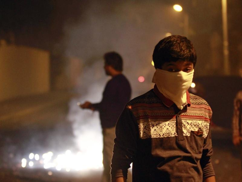 A boy wearing a mask to protect himself against air pollution as fire crackers add to the smog and air pollution on Diwali (Deepawali) in New Delhi. (Arvind Yadav/ Hindustan Times)