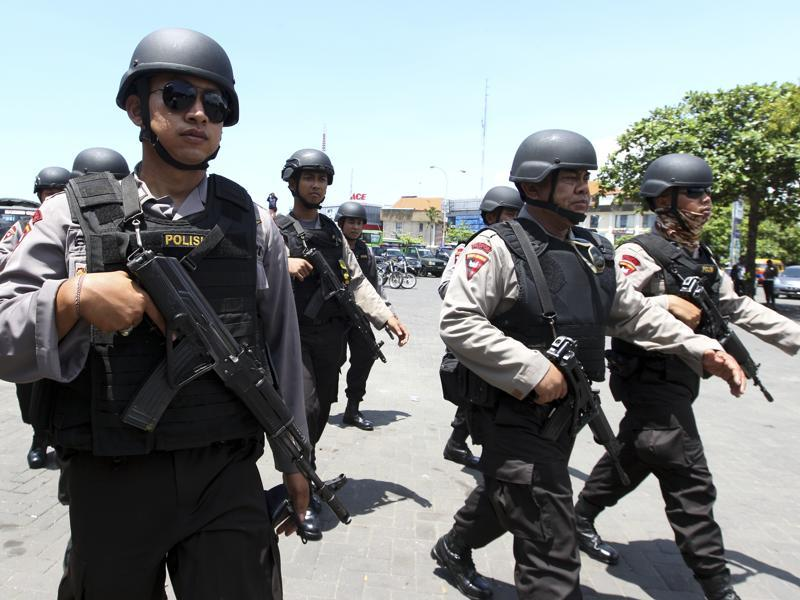 Police officers are deployed to secure New Year celebrations in Bali, Indonesia. Indonesia is on high alert after authorities said last week that they had foiled a plot by Islamic militants to attack government officials, foreigners and others in the world's most populous Muslim nation. (AP Photo/Firdia Lisnawati)