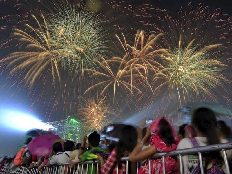Revelers watch as fireworks explode during New Year celebrations outside the Philippine Arena in Bocaue town, Bulacan province, north of Manila. (Reuters)