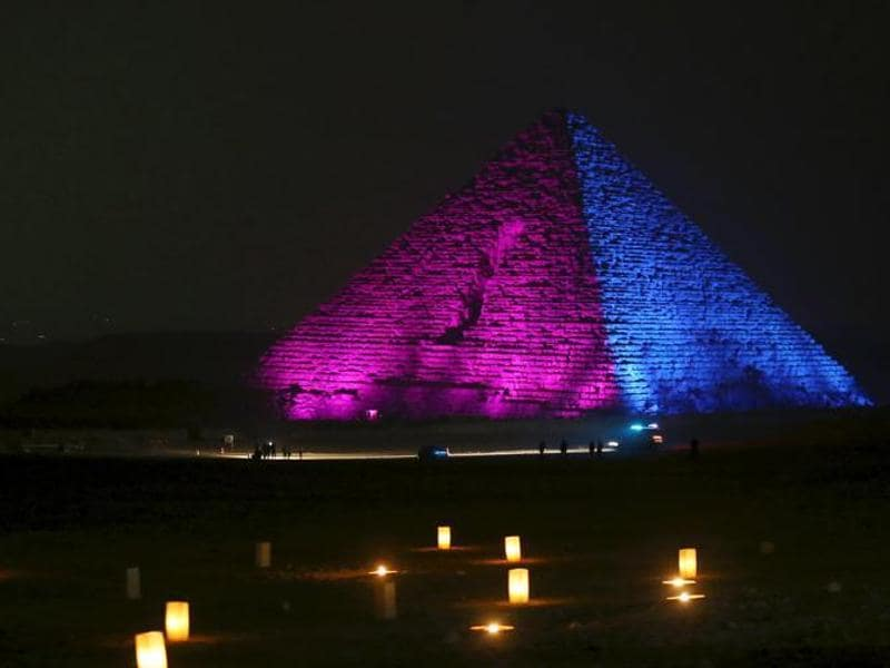 At the Giza Pyramids, hundreds of people gathered for a fireworks and lighting display at the stroke of midnight.  (Reuters)