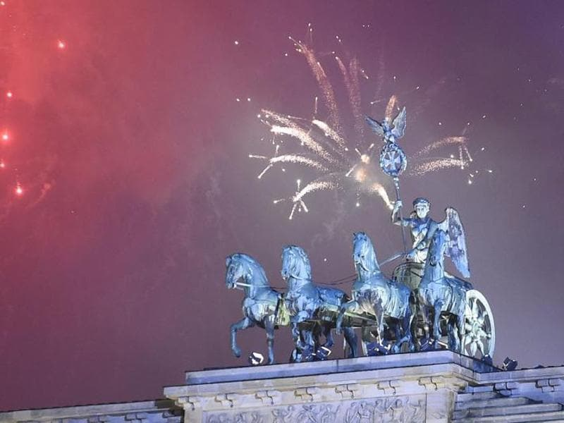 Fireworks explode behind the quadriga of Berlin's Brandenburg Gate to usher in the new year.  (AFp Photo)